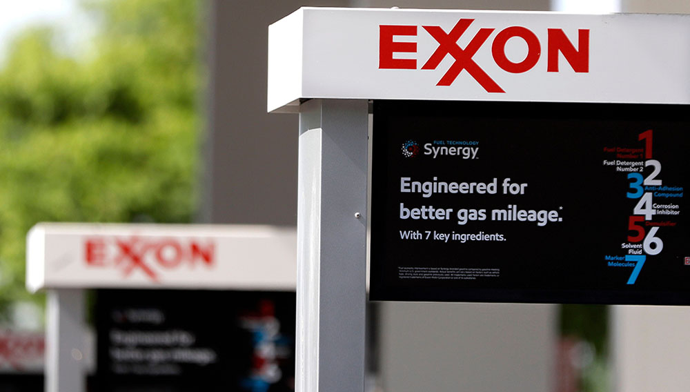 This April 25, 2017, photo, shows Exxon service station signs in Nashville, Tenn. The gasoline company is being sued by the state of New York for misleading investors regarding climate change. AP/REX/Shutterstock