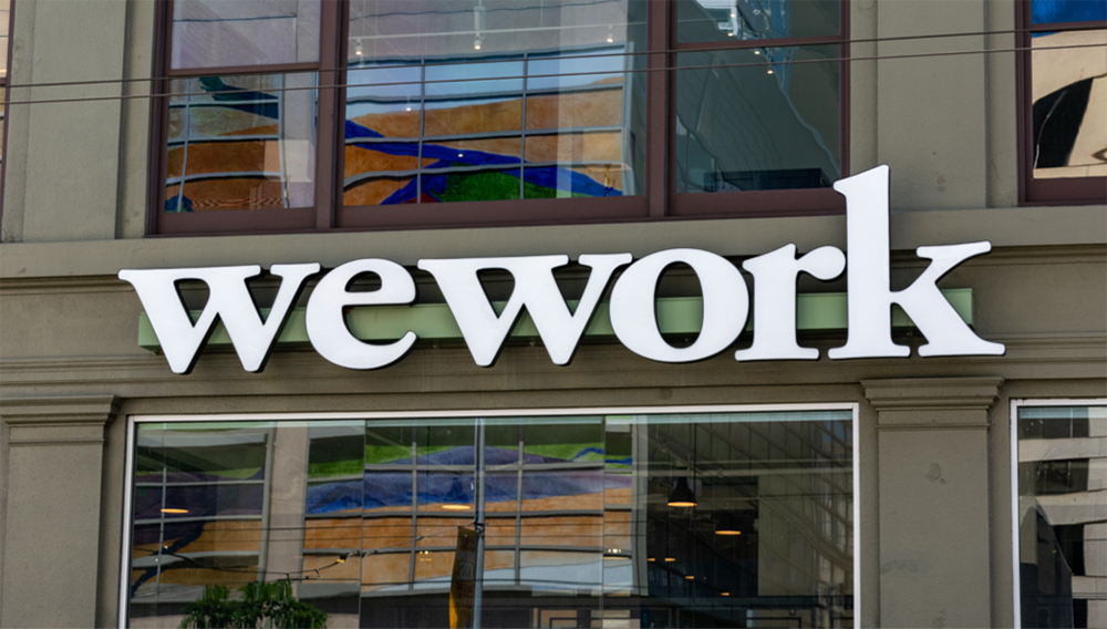 WeWork sign on shared coworking space of The We Company startup at South of Market (or SoMa) neighborhood - San Francisco, California, USA - July 12, 2019. Shutterstock
