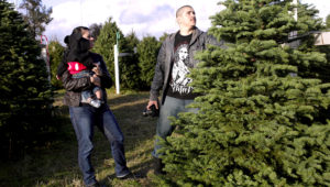 Paco Torres, right, of Fairfield, shops for a Christmas tree with his wife, Sophia, and their 4-month old son Jeremiah at Dick's Christmas Tree Sales in Lagoon Valley. (Brad Zweerink/Daily Republic)