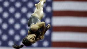 Simone Biles practices on vault for the senior women's competition at the 2019 U.S. Gymnastics Championships Sunday, Aug. 11, 2019, in Kansas City, Mo. (AP Photo/Charlie Riedel)