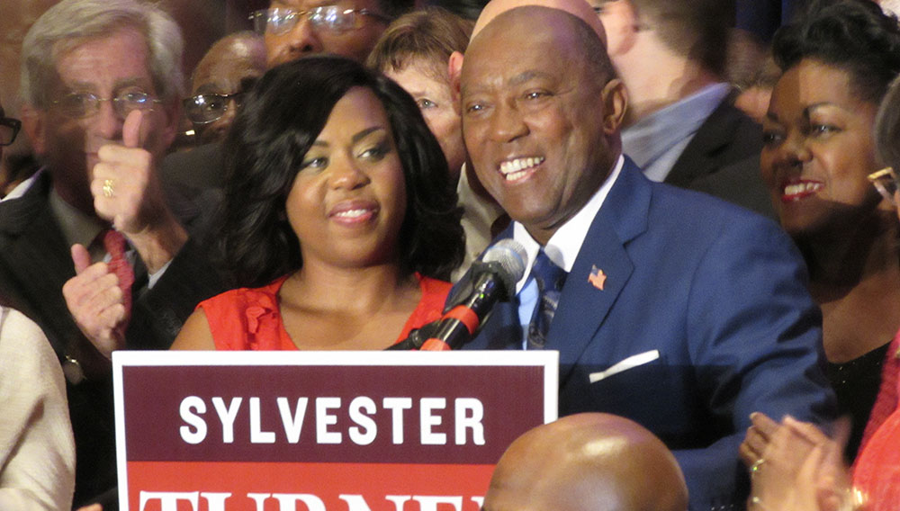Sylvester Turner and daughter Ashley Turner (left) thank supporters on election night. Photo: Gail Delaughter/Houston Public Media