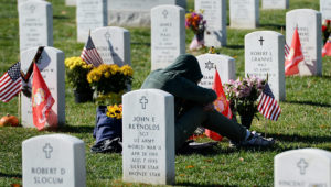 An Unidentified Woman Mourns in Section 60 of Arlington National Cemetery on Veteran's Day in Arlington Virginia Usa 11 November 2013 Section 60 is the Final Resting Place For the Majority of Casualties at Arlington National Cemetery That Died From Operation Iraqi Freedom in Iraq and Operation Enduring Freedom in Afghanistan United States Arlington. EFE/Michael Reynolds