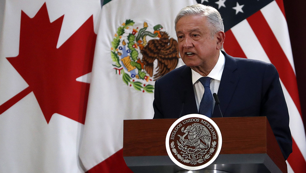 Mexico's President Andres Manuel Lopez Obrador speaks during an event to sign an update to the North American Free Trade Agreement, at the national palace in Mexico City, Tuesday, Dec. 10. 2019. (AP Photo/Marco Ugarte)