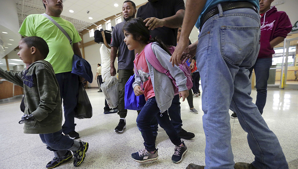 A group of immigrants from Honduras and Guatemala seeking asylum arrive at the bus station after they were processed and released by U.S. Customs and Border Protection in McAllen, Texas. (Photo: Eric Gay, AP Images)