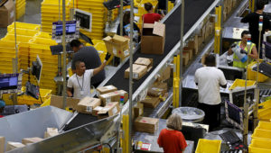 Workers sort arriving products at an Amazon Fulfilment Center in Tracy, California, August 3, 2015. Photo: Reuters