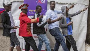 """Condom King"" Stanley Ngara, second left, and pop star Tetu Shani, second right, help teach young Kenyans (Jan Husar)"