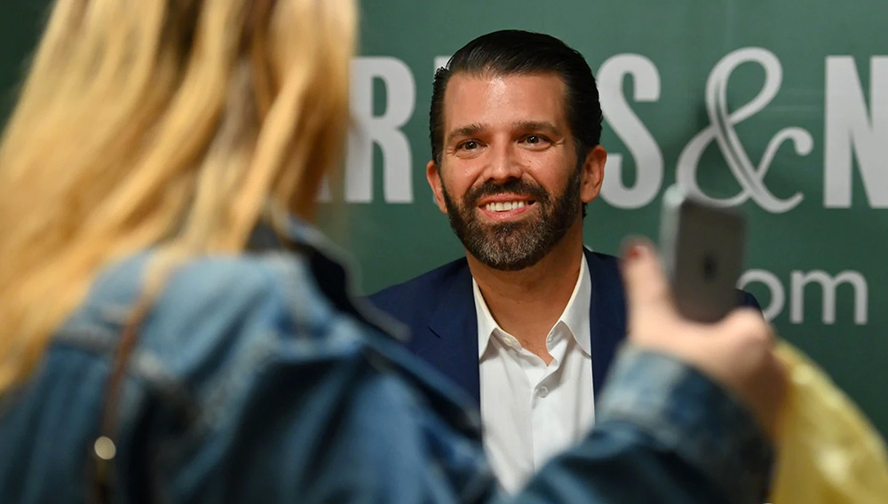 """Donald Trump Jr., signs his new Book """"Triggered: How the Left Thrives on Hate and Wants to Silence Us"""" at Barnes & Noble on 5th Avenue on November 5, 2019 in New York. (Angela Weiss / AFP)"""