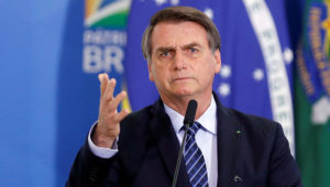 FILE PHOTO: Brazil's President Jair Bolsonaro speaks during a launching ceremony of public policies against violent crimes at the Planalto Palace in Brasilia, Brazil August 29, 2019. REUTERS/Adriano Machado