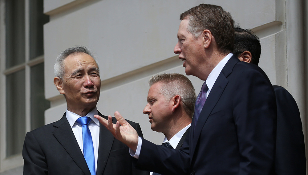 China's Vice Premier Liu He listens to U.S. Trade Representative Robert Lighthizer as they exit the office of the U.S. Trade Representative following a second day of last ditch trade talks in Washington, U.S., May 10, 2019. REUTERS/Leah Millis