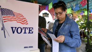 Rosa Ayala checks her ballot after voting in the US presidential primary June 7, 2016 at Sabores de Oaxaca, a Mexican restaurant in Los Angeles, California. (MICHAEL OWEN BAKER/AFP/Getty Images)