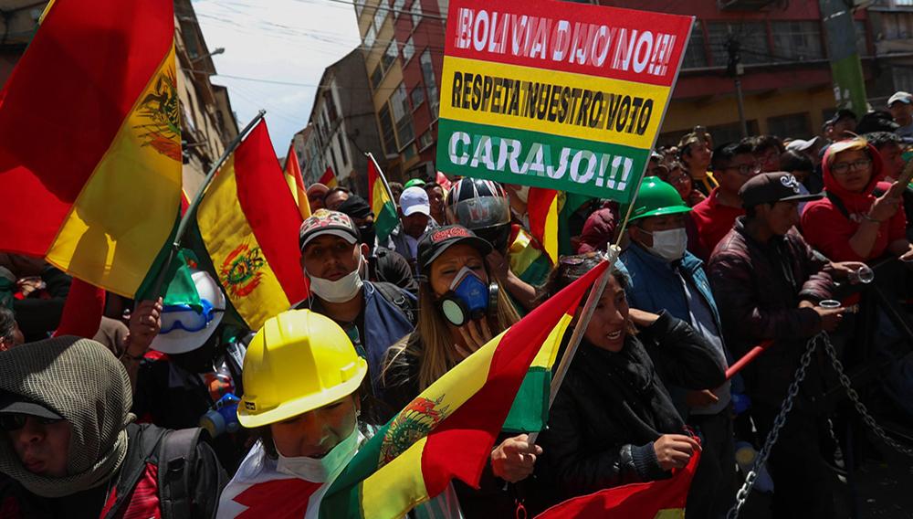 Bolivian citizens protect an entrance to Plaza Murillo, where policemen have withdrawn to, in La Paz, Bolivia, 09 November 2019. EPA/Martin Alipaz