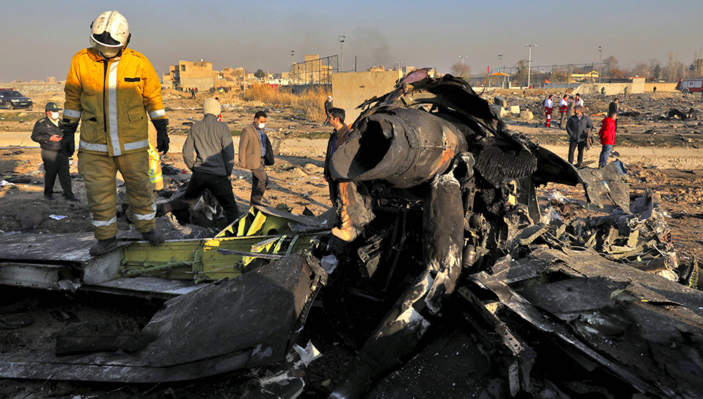 Rescue workers searched the scene where a Ukrainian plane crashed in Shahedshahr, southwest of the capital Tehran, Iran on Wednesday. EBRAHIM NOROOZI/ASSOCIATED PRESS