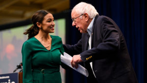 U.S. Rep. Alexandria Ocasio-Cortez (D-NY) is joined on stage by Democratic Presidential candidate Bernie Sanders (I-VT) during the Climate Crisis Summit at Drake University on November 9, 2019 in Des Moines, Iowa. Stephen Maturen | Getty Images