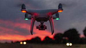 Dron volando en un atardecer. Photostock
