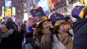People celebrate the New Year in Times Square in New York, early Wednesday, Jan. 1, 2020, (AP Photo/Craig Ruttle)