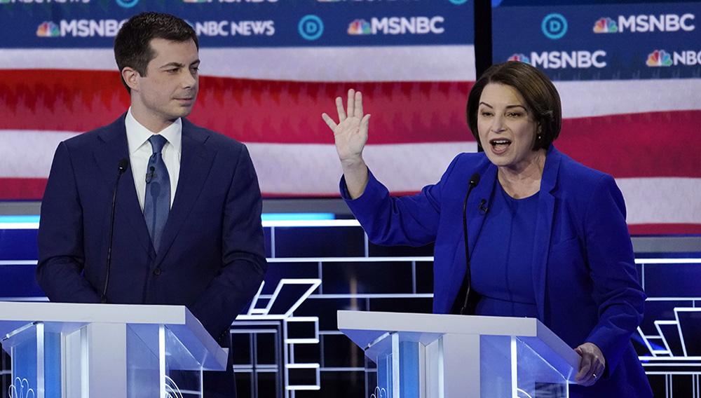 Sen. Amy Klobuchar speaks as former South Bend, Ind., mayor Pete Buttigieg listens during the ninth Democratic debate, in Las Vegas. (Mike Blake/Reuters)