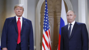 U.S. President Donald Trump, left, and Russian President Vladimir Putin pose for a photograph at the beginning of a one-on-one meeting at the Presidential Palace in Helsinki, Finland, Monday, July 16, 2018. (AP Photo/Pablo Martinez Monsivais)