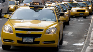 """Cabs line up for fares outside the Port Authority Bus Terminal January 12, 2010 in New York. There are about 13,000 """"Medallion taxis,"""" (those with an aluminum plaque bolted to the hood of the cab) in New York City. (DON EMMERT/AFP/Getty Images)"""