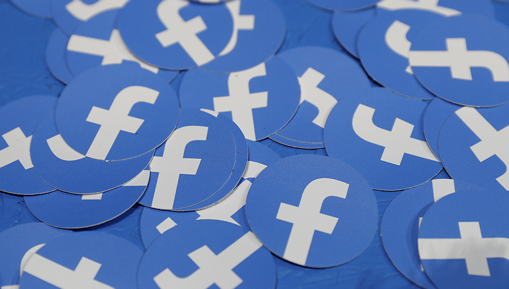 FILE PHOTO: Stickers bearing the Facebook logo are pictured at Facebook Inc's F8 developers conference in San Jose, California, U.S., April 30, 2019. REUTERS/Stephen Lam/File Photo