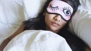 High angle view of woman wearing eye mask. Royalty free image. DALINA RAHMAN / EYEEM / GETTY IMAGES
