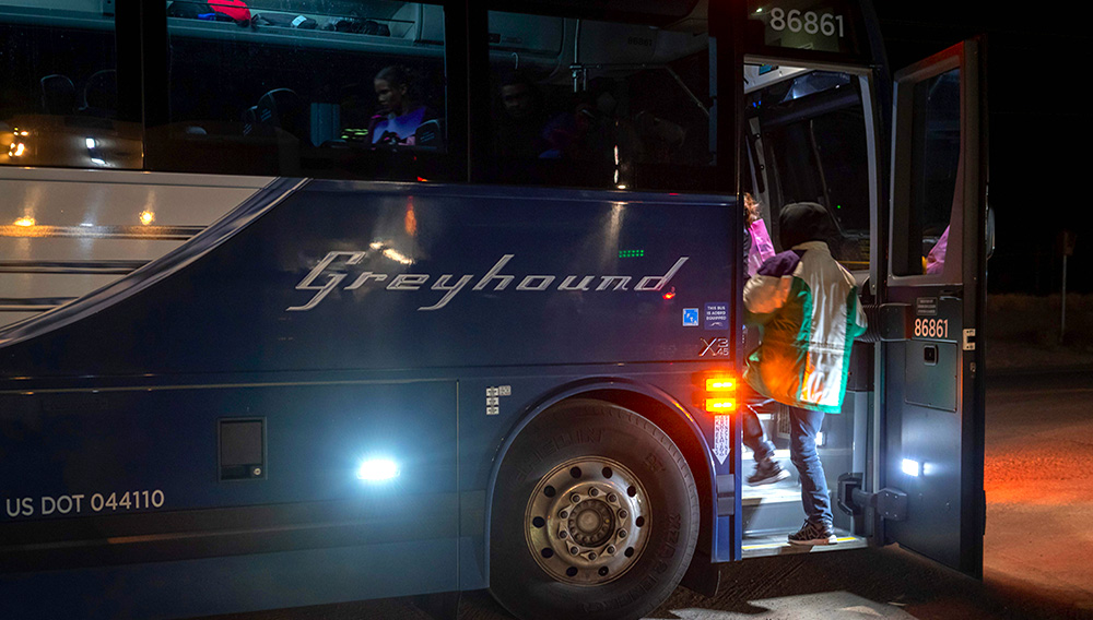 Passengers board a Greyhound bus on Jan. 3, 2019. Paul Ratje—AFP/Getty Images