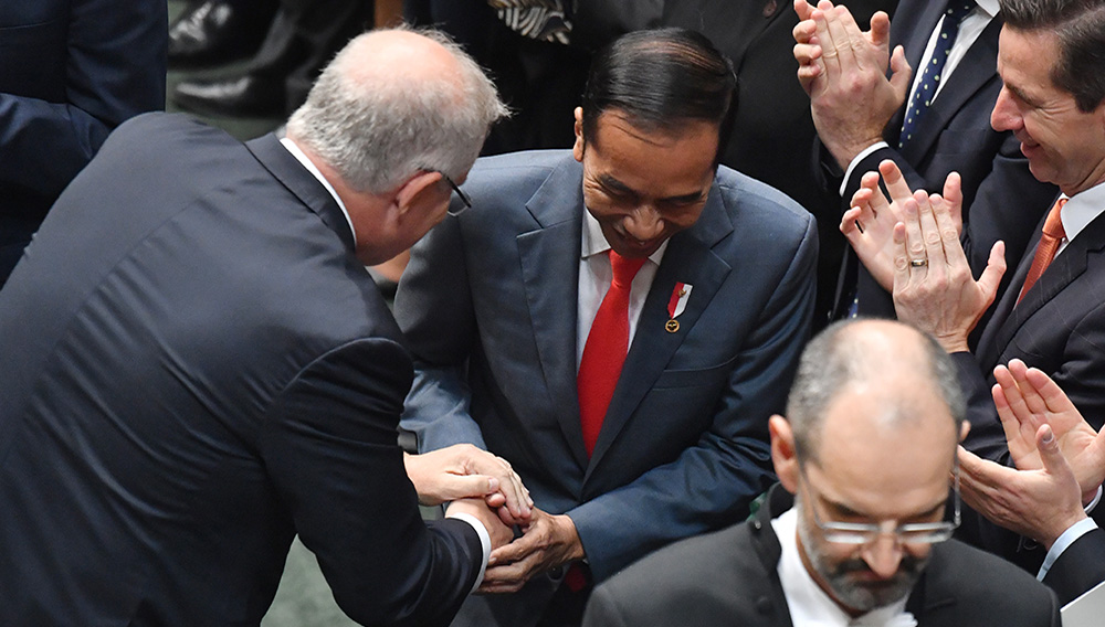 The PM and Mr Widodo shake hands before his address to the House of Representatives. | AAP