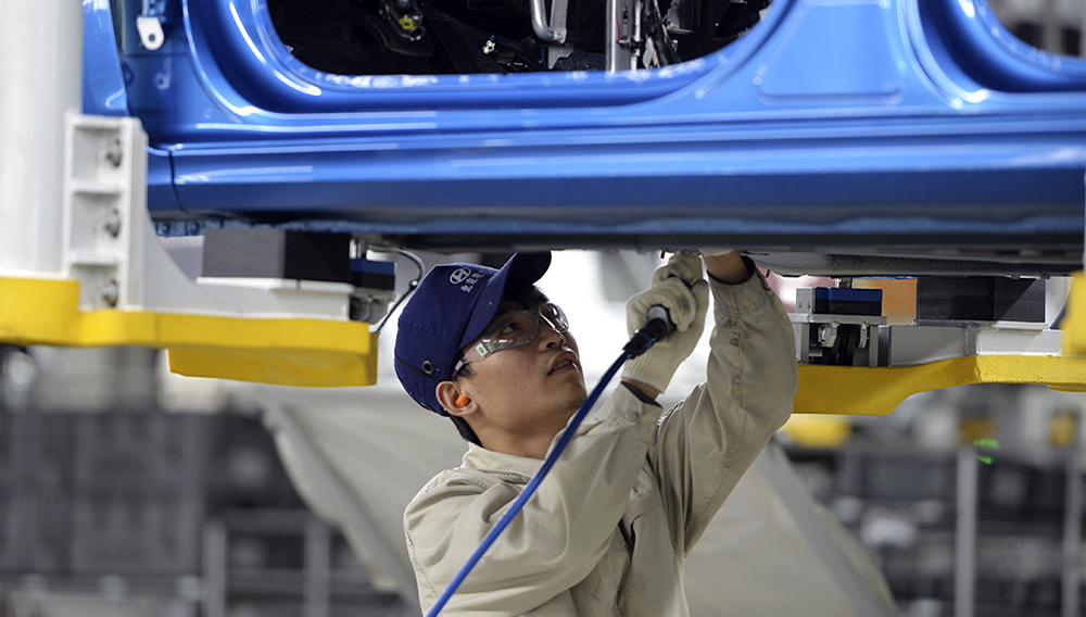 This photo taken on February 21, 2017 shows a worker in a Hyundai factory in Cangzhou, in China's northern Hebei province. The factory is the South Korean manufacturer's fourth in China and has an annual capacity of 300,000 cars. (Photo credit should read STR/AFP via Getty Images)