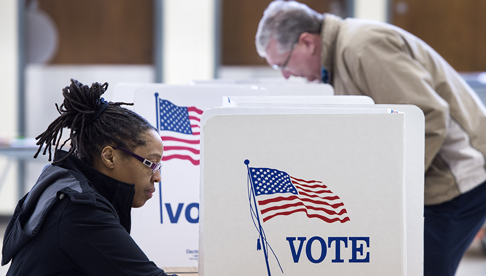 People vote in the Super Tuesday primary at Centreville High School March 1, 2016, in Centreville, Virginia. (Photo credit should read PAUL J. RICHARDS/AFP/Getty Images)