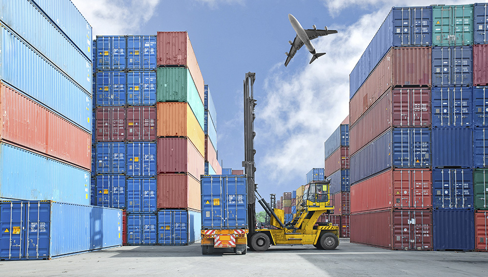 Crane lifter handling container box loading to truck. | Ake1150/Fotolia