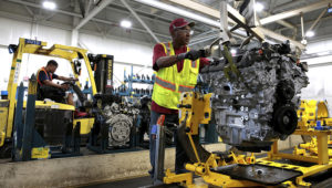 A worker moves an engine from the final assembly line at the GM Romulus Powertrain plant in Romulus, Michigan, on Aug. 21, 2019. (Photo: Rebecca Cook/Reuters)