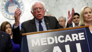 "Senator Bernie Sanders introducing the ""Medicare for All Act of 2017"" in September. REUTERS/YURI GRIPAS"