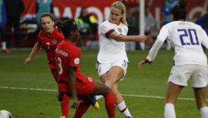 U.S. midfielder Lindsey Horan scores past Canada defender Kadeisha Buchanan during the second half of a CONCACAF women's Olympic qualifying soccer match Sunday, Feb. 9, 2020, in Carson, Calif. The U.S. won 3-0. Photo: Chris Carlson, The Associated Press.
