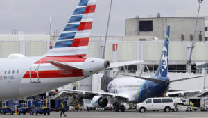 An American Airlines plane at left, leaves a gate area near an Alaska Airlines plane, Thursday, Feb. 13, 2020, at Seattle-Tacoma International Airport in Seattle. Ted S. Warren | AP