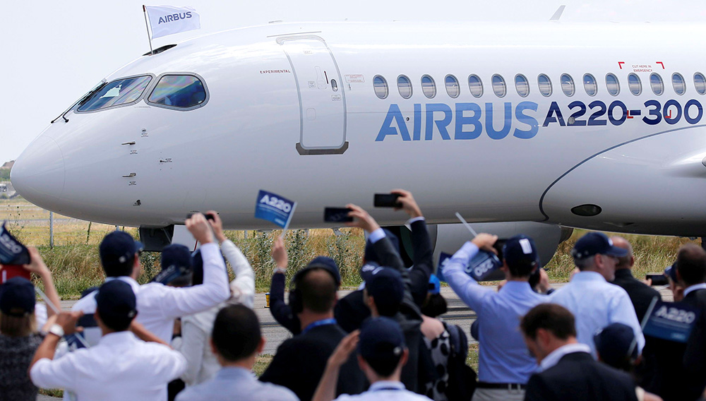 Airbus members celebrate the landing of an Airbus A220-300 aircraft during its presentation in Colomiers near Toulouse, France, July 10, 2018. Airbus A220 is the new brand for the small CSeries passenger jet acquired from Canada's Bombardier. Regis Duvignau | Reuters