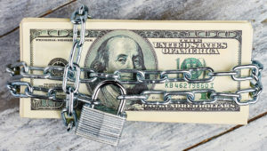 100 US dollars, chain, lock. Photostock