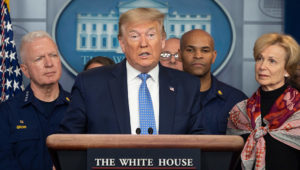 US President Donald Trump standing with members of the White House Coronavirus Task Force team, speaks during a press briefing in the press briefing room of the White House March 15, 2020 in Washington, DC. (Photo by JIM WATSON/AFP via Getty Images)