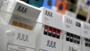 Juul products are displayed at a smoke shop in New York in 2018. SETH WENIG / AP