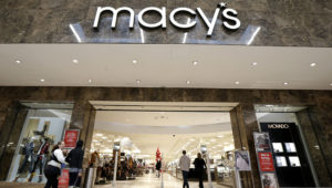 People walk into a Macy's department store at Garden State Plaza in Paramus, N.J., in 2017. (Julio Cortez/AP)