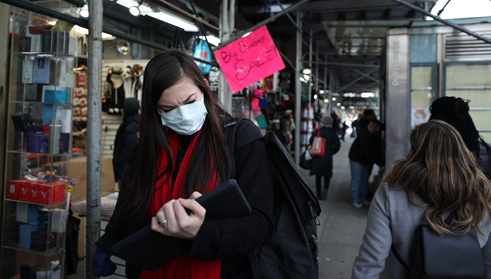 People wear medical masks as a precaution against coronavirus, walking around the in the streets of New York, United States on January 30, 2020.Tayfun Coskun | Anadolu Agency via Getty Images