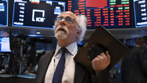 Trader Peter Tuchman worked the floor of the New York Stock Exchange on Monday, the day U.S. markets posted their biggest rout since 1987. (Craig Ruttle/AP)
