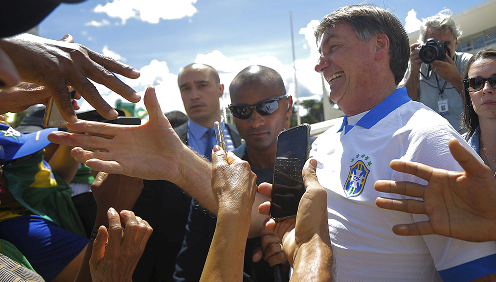 Brazil's President Jair Bolsonaro meets supporters during a protest against Brazil's Congress and Brazilian Supreme Court in front the Planalto Palace in Brasilia. Photo: Adriano Machado/Reuters