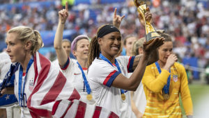 LYON, FRANCE - JULY 07: Jessica McDonald of the USA celebrates with the FIFA Women's World Cup Trophy following her team's victory in the 2019 FIFA Women's World Cup France Final match between The United States of America and The Netherlands at Stade de Lyon on July 07, 2019 in Lyon, France. (Photo by Maja Hitij/Getty Images)