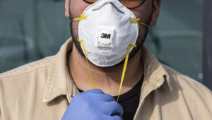 CASALPUSTERLENGO, ITALY - FEBRUARY 23: A man wearinig a respiratory mask and gloves is pictured on February 23, 2020 in Casalpusterlengo, south-west Milan, Italy. Casalpusterlengo is one of the ten small towns placed under lockdown earlier this morning as a second death from coronavirus sparked fears throughout the Lombardy region. (Photo by Emanuele Cremaschi/Getty Images)