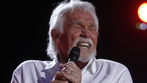 """FILE - In this June 9, 2012, file photo, Kenny Rogers performs at the 2012 CMA Music Festival in Nashville, Tenn. Actor-singer Kenny Rogers, the smooth, Grammy-winning balladeer who spanned jazz, folk, country and pop with such hits as """"Lucille,"""" """"Lady"""" and """"Islands in the Stream"""" and embraced his persona as """"The Gambler"""" on record and on TV died Friday night, March 20, 2020. He was 81. (Photo by Wade Payne/Invision/AP, File)"""