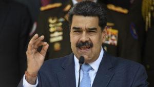 Venezuelan President Nicolas Maduro gives a press conference at the Miraflores Presidential Palace in Caracas, Venezuela, Thursday, March 12, 2020. (AP Photo/Matias Delacroix)