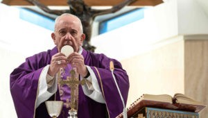 This photo taken and handout on March 10, 2020 shows Pope Francis celebrating a daily mass alone in the Santa Marta chapel at the Vatican, as part of precautionary measures against the spread of the new coronavirus. (Credit: AFP Photo)