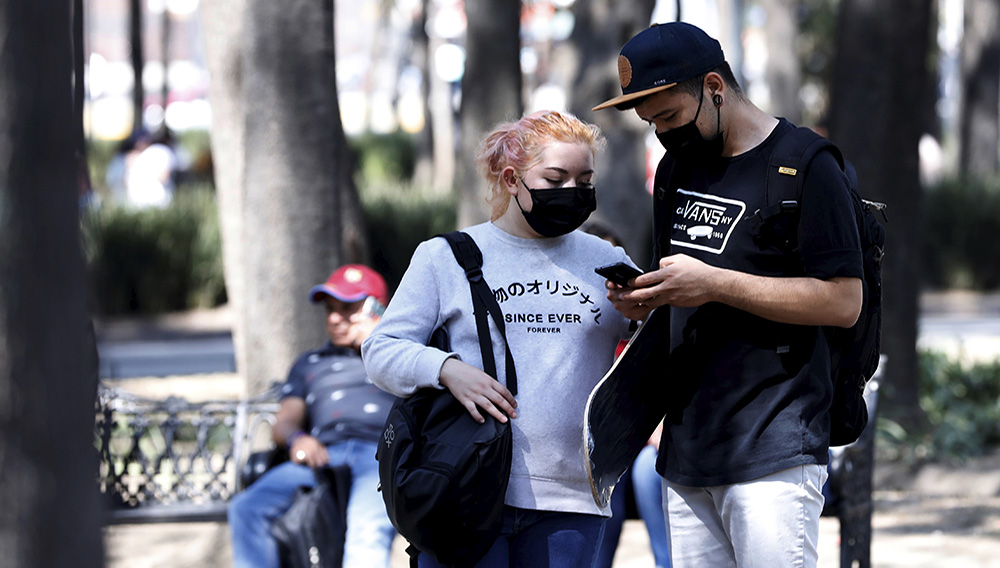 A couple wear protective face masks on the street after the governor of the northern Mexican state of Coahuila said on Saturday that a new case of coronavirus had been confirmed, in Mexico City, Mexico February 29, 2020. REUTERS/Carlos Jasso
