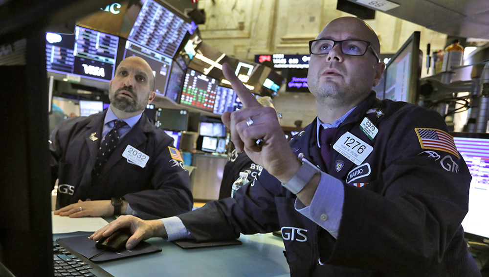 Specialists James Denaro, left, and Mario Picone work on the floor of the New York Stock Exchange, Tuesday, March 10, 2020. Stocks, Treasury yields and oil are clawing back some of the plunge they took a day before, when the S&P 500 had its worst drop in more than a decade. (AP Photo/Richard Drew)