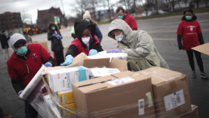Community health workers in the U.S. could take on many Covid-19-related tasks, including preparing personal protective equipment, as these volunteers from Project C.U.R.E are doing in Chicago. SCOTT OLSON/GETTY IMAGES