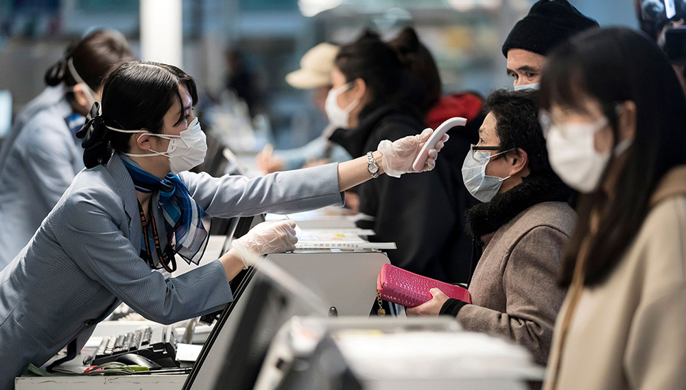 Eleven airports in the United States are using these temperature checks as part of expanded screening for novel coronavirus, and those measures might seem reassuring. Tomohiro Ohsumi/Getty Images
